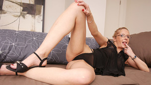 Blonde floozy is licking her teats and fingering cunt hole