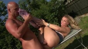 Blonde with big whoppers is getting her hawt feet licked outdoors