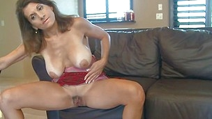 She`s sexy, busty and has a dildo that her cunt needs it. Meet Mom Tori, a slut that needs to acquire off. She plays with her big, soft boobs in front of us and then takes a sit on the couch, spreads her legs and uses that sex toy on her pussy. That`s rig