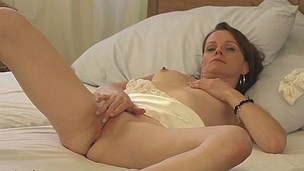Nasty housewife playing with her wet cunt